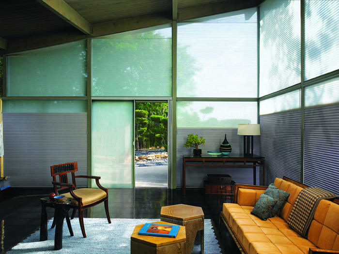 Green House inspired glass walled living room