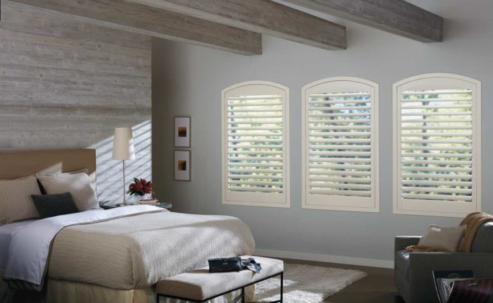 furnished bedroom with shuttered windows