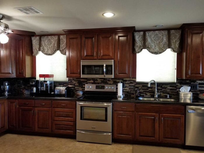 kitchen space with modular kitchen furnishings and cooking range