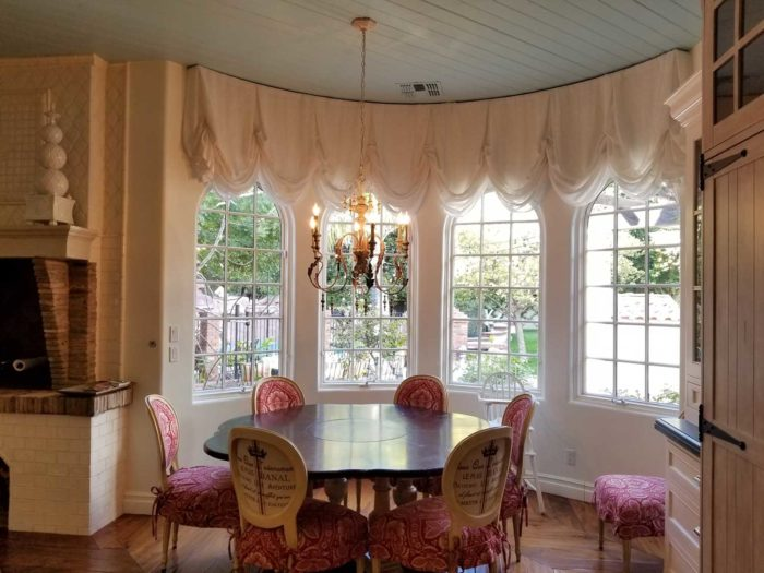 circular dining space with multiple window panels