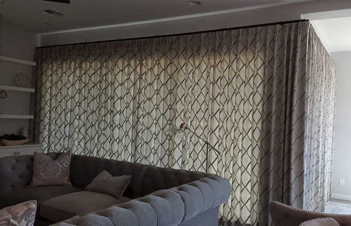 Living space with large curtained window