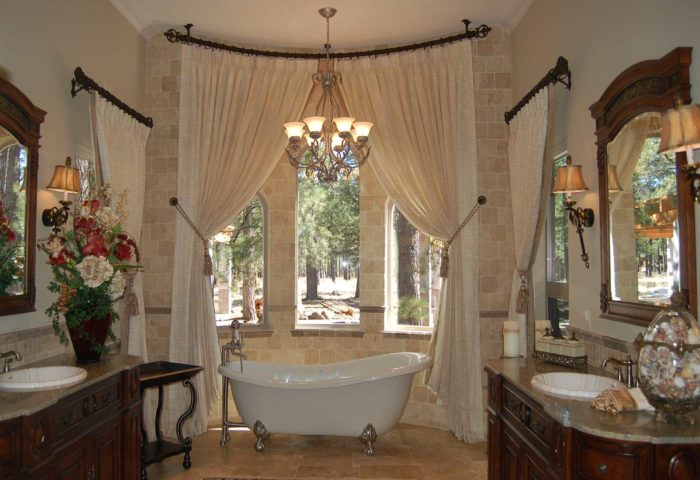 ornately decorated bathroom with three curved windows