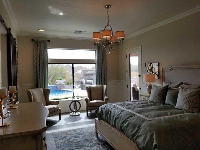bedroom with window overlooking a pool
