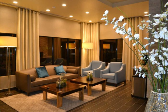 well-furnished living space with warm lighting