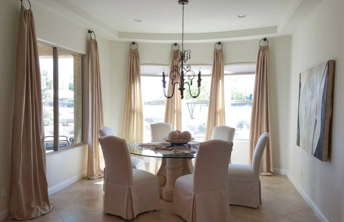well-furnished dining space with large windows