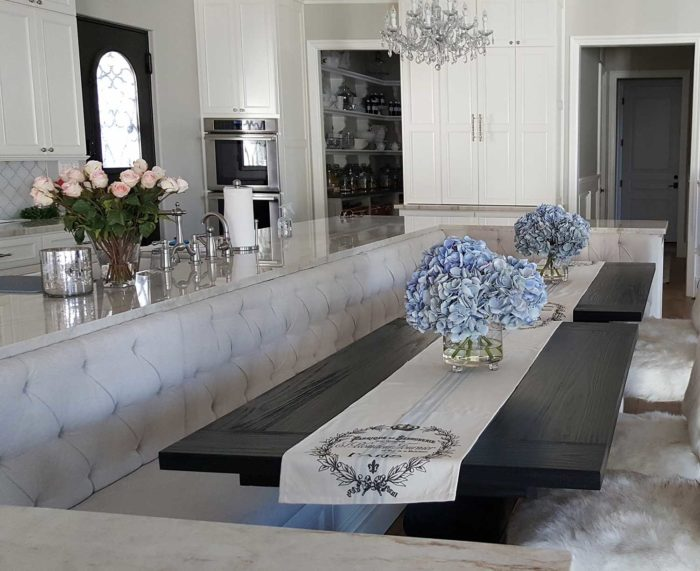Tufted Bench Seating in dining area next to kitchen area