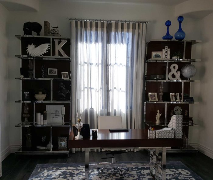 window in-between shelves with knick knacks