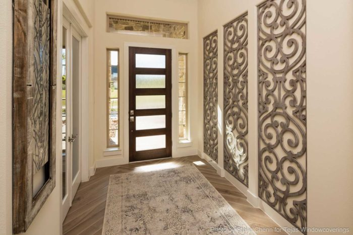 hallway with metalwork on the walls